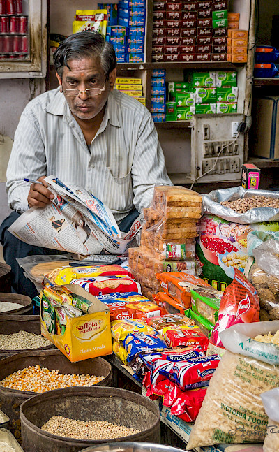 Shopkeeper in New Delhi, India. Flickr:Steven dosRemedios