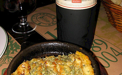 Dining with delicious Malbec wine in Argentina. Flickr:Barnaby Dorfman