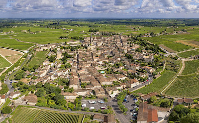 Surrounding by rolling vineyards is the town of Saint-Émilion, France. CC:Chensiyuan