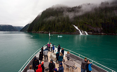 Guests on bow in Misty Fjords National Monument in Alaska. ©TO
