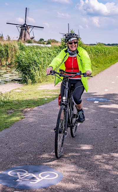 Cycling past windmills in the Netherlands. ©TO