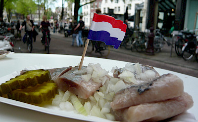 Herring with raw onions - a Dutch favorite! Flickr:WordRidden