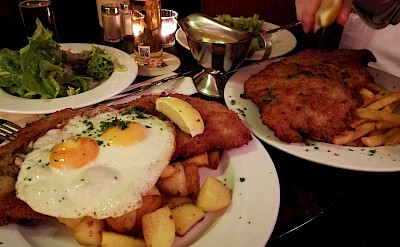 Schnitzel with eggs and fries in Cologne, Germany. Flickr:Aleksandr Zykov