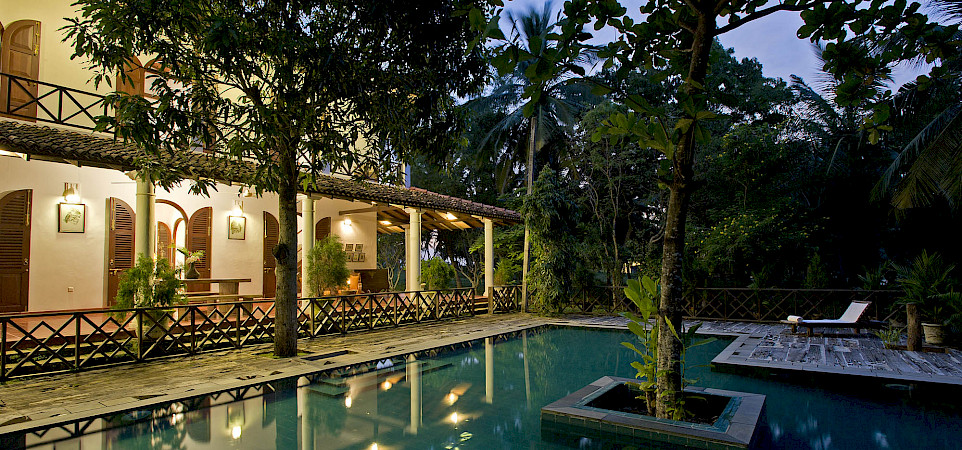 Oceans Edege Pool And Villa Lit Up At Night 1
