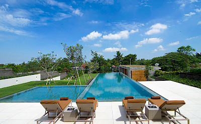 The Iman Villa Sunloungers By The Pool
