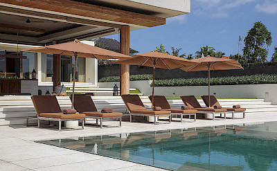 The Iman Villa Sun Loungers By The Pool